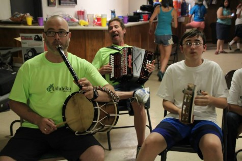 At the camp, the kids are exposed to traditional Basque instruments like the pandero (tambourine), ttunttun (small drum), txistu (recorder) and trikitixa (button accordion).  Teachers this year are Jexux Larrea (back) and Eneko Espino (left. Camper Jean Jules Flesher plays the pandero. (Lisa Corcostegui).